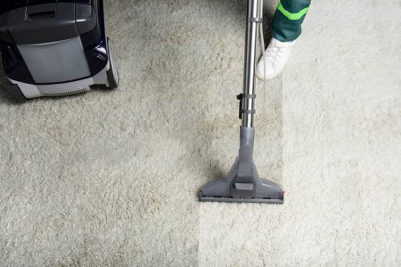Performing carpet cleaning services